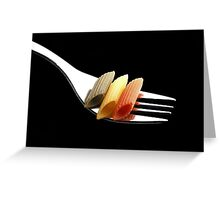italian penne pasta on a fork on black background Greeting Card