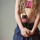 Girl holding a coke bottle  by kerryvarnum