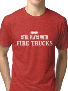 Still plays with firetrucks Tri-blend T-Shirt