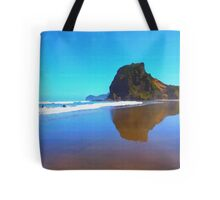 Iconic Lion Rock reflected on famous Piha Beach, Auckland Tote Bag