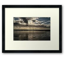 Sun rays through the clouds Framed Print