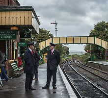Chatting on a wet Platform 2 by Judi Lion
