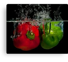 Splashing peppers Canvas Print
