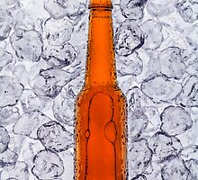 Beer on ice cubes fragmented in vertical by Pablo Romero