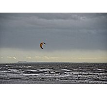 A Lone Kite Surfer Flying Across Stormy Seas Photographic Print