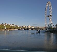 ,Blue sky over the London eye on the southbank in London by Keith Larby