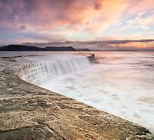 Sunrise falls at Lyme Regis Cobb by Chris Frost Photography