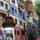 Front of a colourful building by Hundertwasser, Vienna by Ilan Cohen