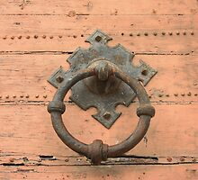 doorknocker on wooden background by orsinico