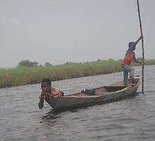 Boys on Boat- Ghana by TravelGrl
