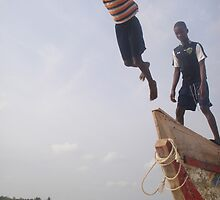 Ghana boys jumping off boat by TravelGrl