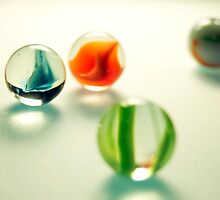 Marbles yellow light  by Anthony Cooley