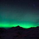 northern lights over mountain ridge by tara romasanta
