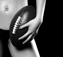 Woman with a Football art photo print by ArtNudePhotos