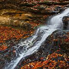Cascading Autumn Waterfall by Kenneth Keifer