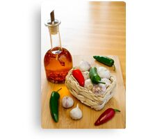 Garlic and Chilli Basket With Oil Canvas Print