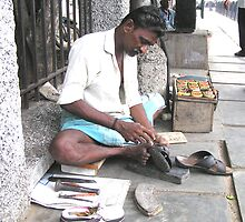 My sandals being resized, Chennai, India by indiafrank