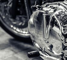 Motorbike engine with reflections of a paved street by Olivier Sohn