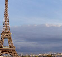Eiffel tower on a cloudy sky in Paris by Olivier Sohn