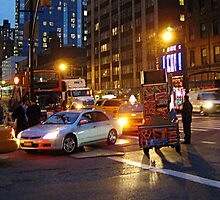 A NYC Traffic Jam at night including a food vendor  by Jane Neill-Hancock