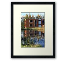 Modern buildings on the lake Framed Print
