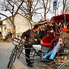 Rickshaws in Beijing city by Robyn Lakeman