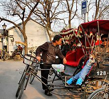Rickshaws in Beijing city by Robyn Lakeman
