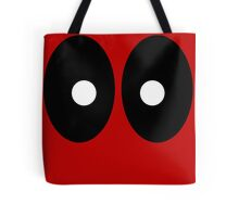 Red field behind black ellipses and white circles. Tote Bag