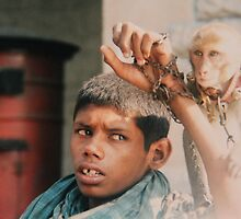 Intellectually disabled boy and his monkey, India by indiafrank