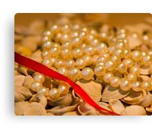 Red ribbon and pearls Canvas Print