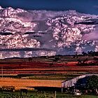 Storm clouds and country sheds by GeoffSporne