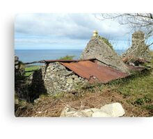 Tumbledown cottage with a sea view Canvas Print