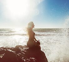 Young Woman Meditating by the Sea by visualspectrum