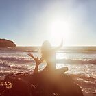 Young Woman Doing Beach Yoga by visualspectrum