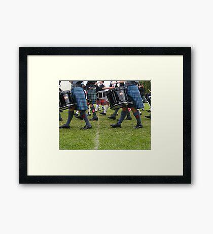 Marching kilts Framed Print