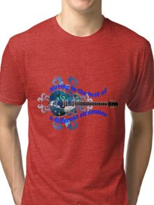 Moving To The Beat Of A Different Strummer Guitar Tri-blend T-Shirt