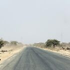 The dusty road to Serengeti, Tanzania by Hannah Nicholas