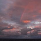 Sunset with rainbow in the Atlantic Ocean by Ren Provo
