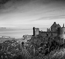 Ireland Panorama BW - Dunluce Castle by lesslinear
