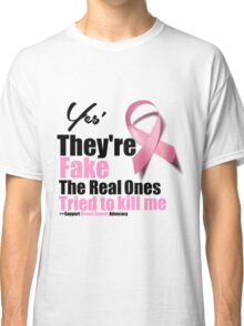 Yes They're fake. My real ones tried to kill me. Classic T-Shirt