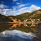 The stone bridge of Kompsatos river by Hercules Milas