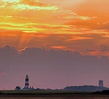 Sun rays over Happisburgh by Avril Harris