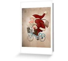 Santa Claus rides a bicycle Greeting Card