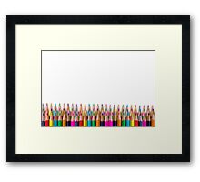 rows of colored pencil on white background Framed Print