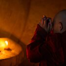 Novices praying at the reclining Buddha by Mark Prior