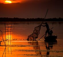 Fisherman at sunset by radudumitrescu
