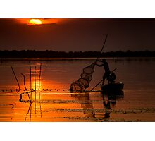 Fisherman at sunset Photographic Print