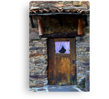 Wooden door with curtains in schist cottage Canvas Print