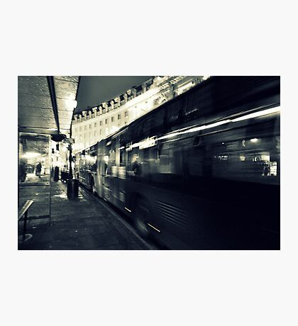 Waiting for the night bus in the dark city street Photographic Print