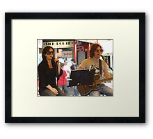 Entertaining the passing parade Framed Print